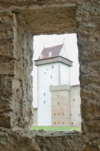View of the castle through a window in the wall