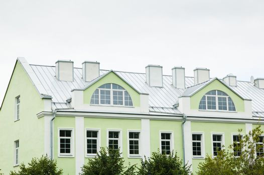 Detail of the facade of the old green building