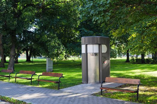 Modern automatic self cleaning, pay for use public toilet in the Park
