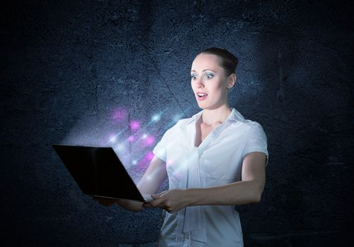 young attractive woman holding a laptop