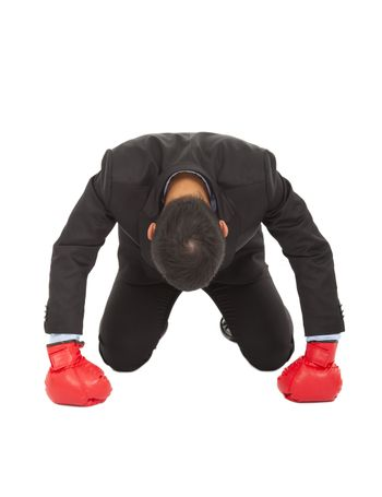 businessman losed with boxing glove on sneeling position.
