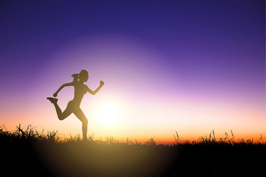 Silhouette of woman running alone at beautiful sunset