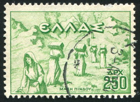 GREECE - CIRCA 1946: stamp printed by Greece, shows Women carrying ammunition in Pindus Mountains, circa 1946