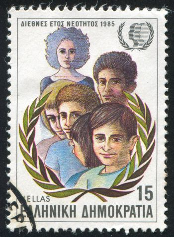GREECE - CIRCA 1985: stamp printed by Greece, shows International Youth Year, Children, olive wreath, circa 1985