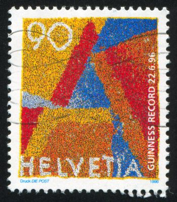 SWITZERLAND - CIRCA 1996: stamp printed by Switzerland, shows Aerial View of 11000 Gymnasts arranged as Letter A, Making Record as World's Largest Living Postage Stamp, circa 1996