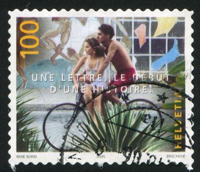 SWITZERLAND - CIRCA 2005: stamp printed by Switzerland, shows Teenagers on bicycle by Rene Burri, circa 2005