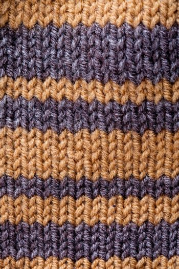 close up macro background of striped knitted texture