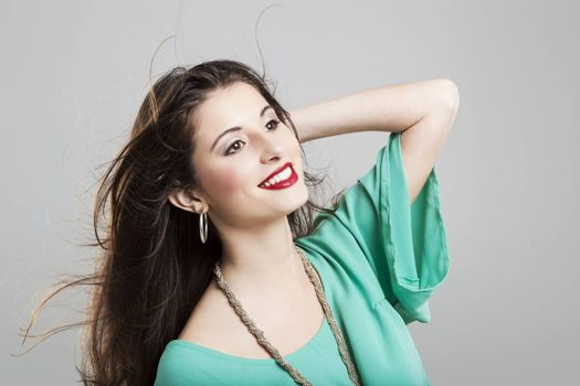 Studio portrait of a beautiful and atractive fashion woman posing