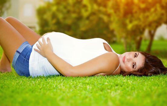 Happy pregnant outdoor
