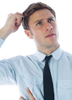 Thinking businessman scratching head
