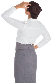 Businesswoman scratching her head