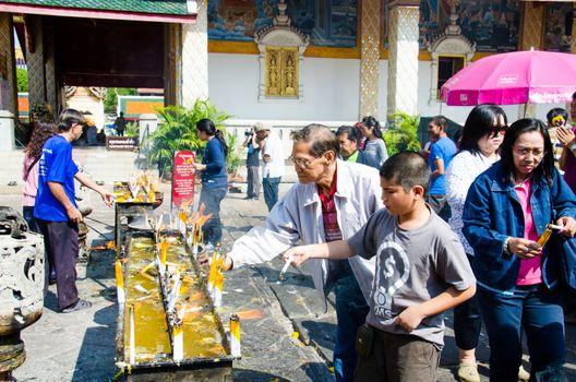 Thai Buddhist prays in a Buddhist merit