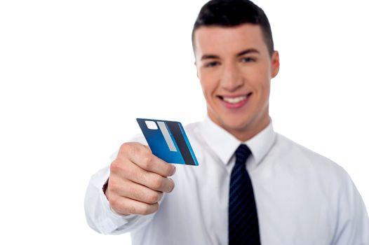 Businessman displaying his cash card