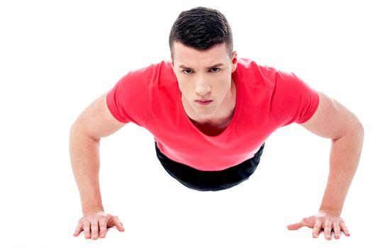 Young man doing push-ups