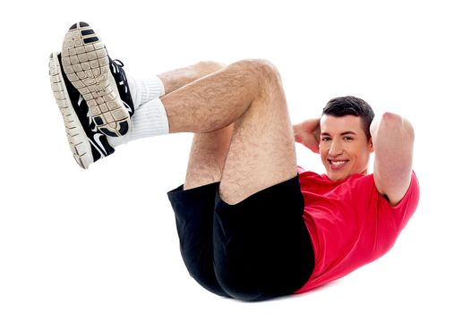 Fitness guy doing crunches