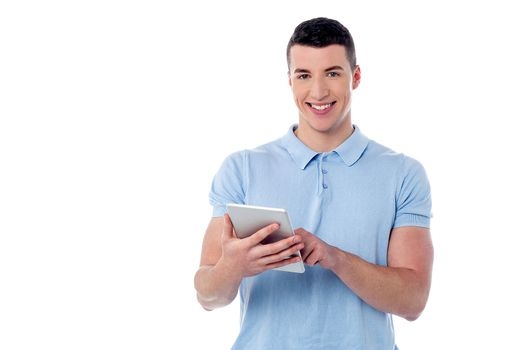 Young guy using his tablet pc