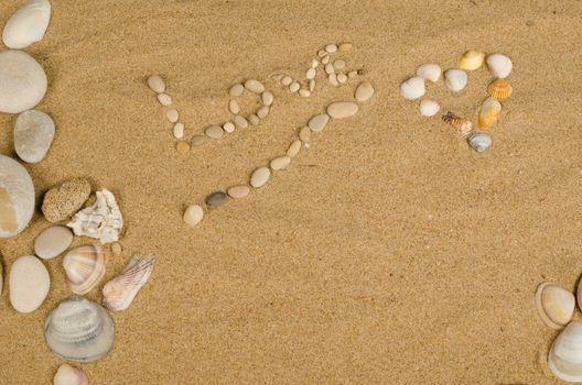A love message on the sand of a sunny beach