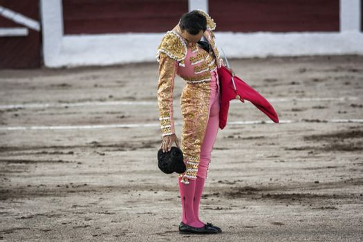 Spanish bullfighter Manuel Jesus El Cid drops his hat on the ground during a bullfight held in Linares
