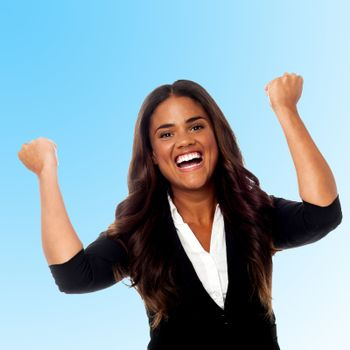 Excited businesswoman with clenched fists
