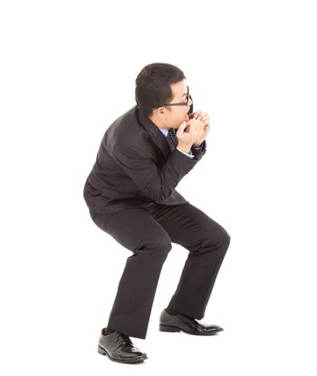 Asian businessman scared and afraid of something