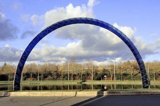 blue arch on a roundabout