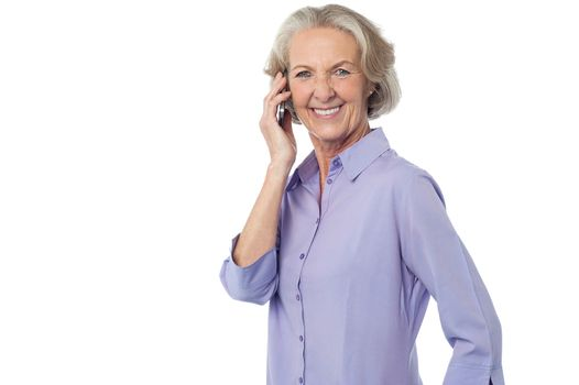 Aged woman attending phone call