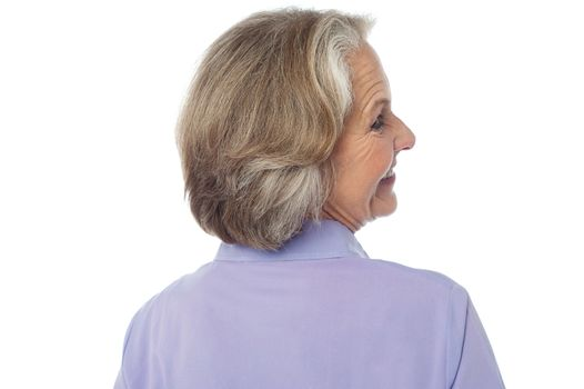Back pose of an old lady
