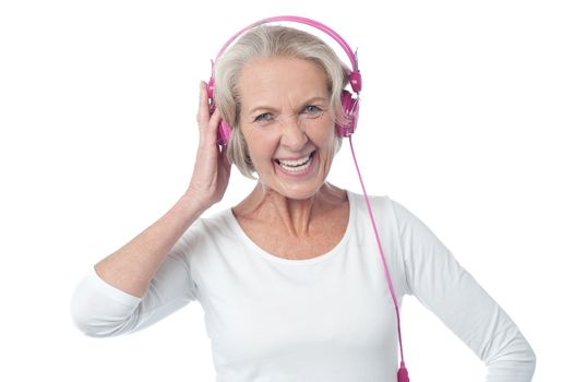Aged woman listening to music