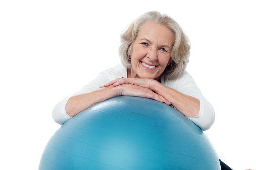 Senior woman posing with exercise ball