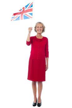 Senior UK supporter waving national flag