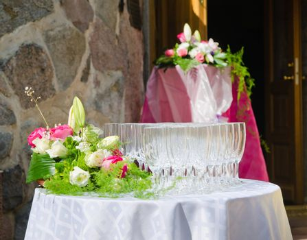 Bouquet of flowers and wine glasses for a wedding table