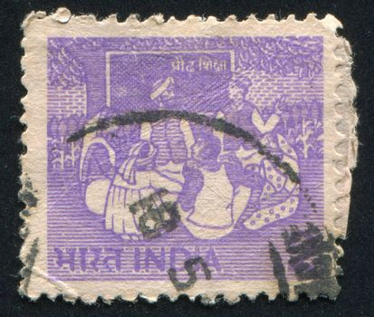 INDIA - CIRCA 1955: stamp printed by India, shows people sitting, circa 1955