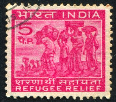 INDIA - CIRCA 1971: stamp printed by India, shows people with packages, circa 1971
