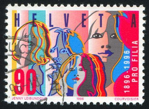 SWITZERLAND - CIRCA 1996: stamp printed by Switzerland, shows Women Faces, circa 1996