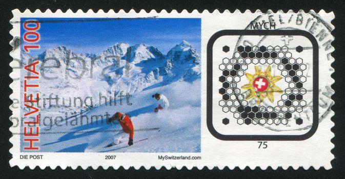 SWITZERLAND - CIRCA 2007: stamp printed by Switzerland, shows Skiers and Swiss Post BeeTagg, circa 2007