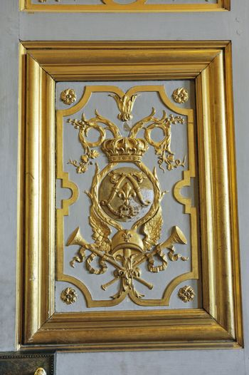 Gilded with fine gold paneling castle of Versailles