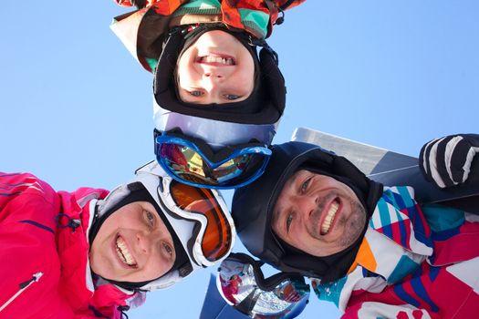 Skiing, winter fun - skiers enjoying ski holidays