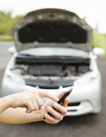 using cell phone to dial service number , a broken car