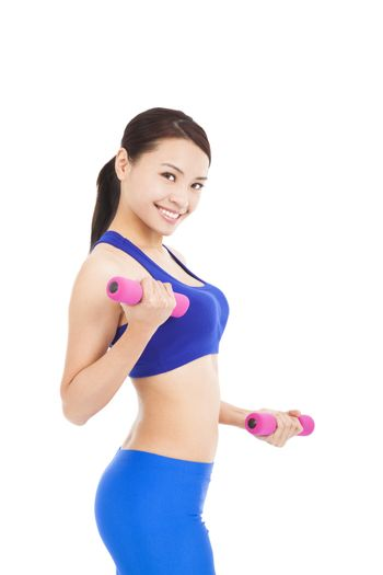 Shot of a sporty young woman with dumbbells