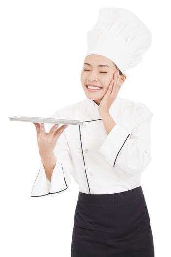 satisfied woman chef holding tray