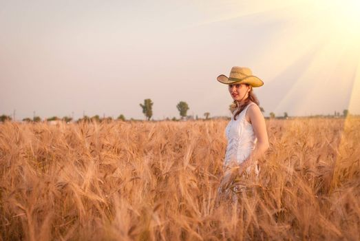 Woman in the wheat field, farmer with crop