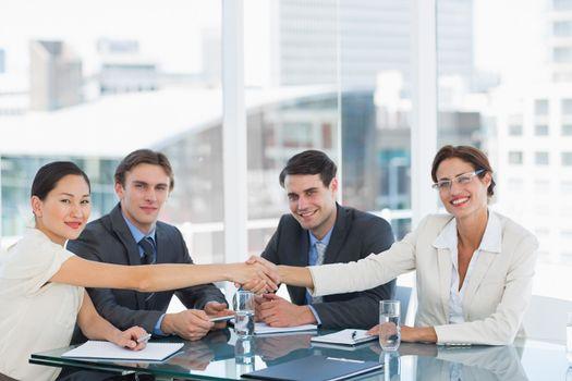 Handshake to seal a deal after a job recruitment meeting