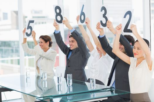 Judges in a row holding score signs