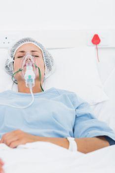 Female patient receiving artificial ventilation