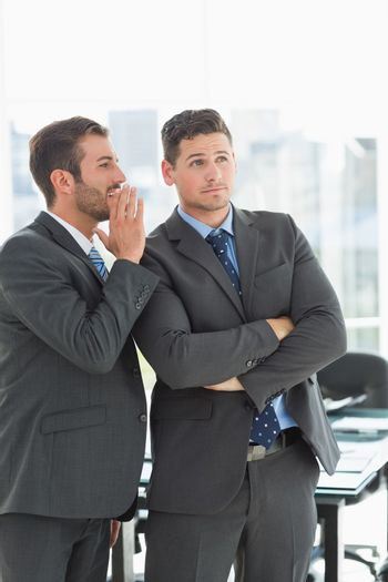 Young well dressed businessmen in discussion