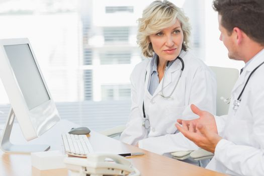 Doctors in discussion at medical office