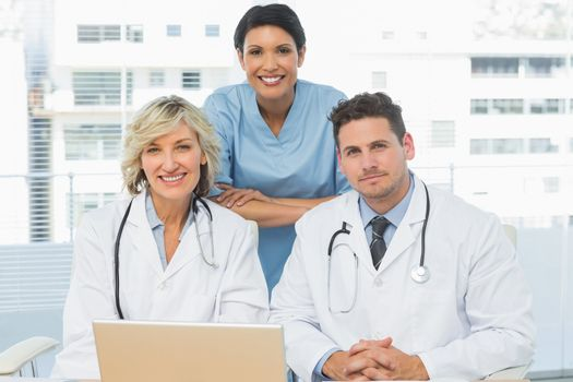 Doctors with laptop at the medical office