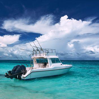 Beautiful island beach with motor boat