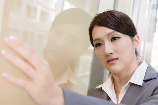 Asian business woman thinking and feel sorrow