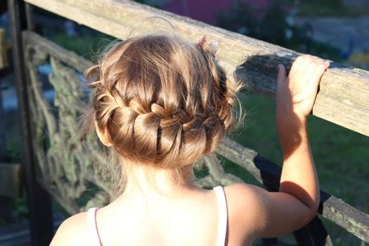 little fashionable girl with beautiful coiffure